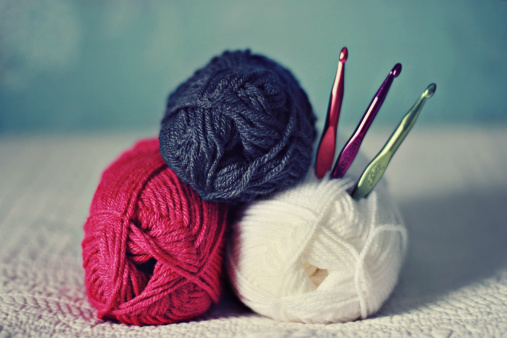 crochet hook & yarn stock image